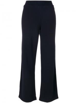 Расклешенные спортивные брюки Jo No Fui. Цвет: синий