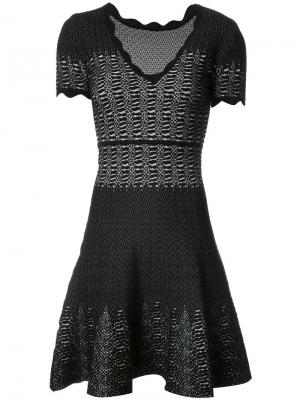 Расклешенное платье с эффектом змеиной кожи Yigal Azrouel. Цвет: чёрный